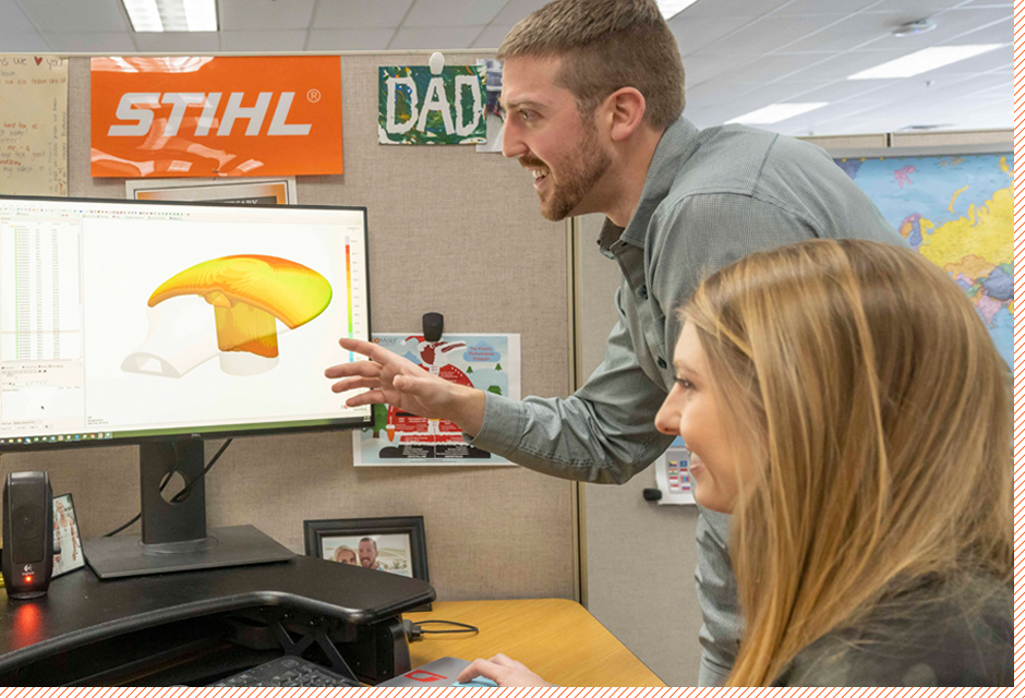 employees viewing model on computer